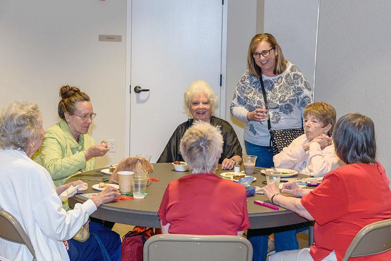 Ladies talking at community meals