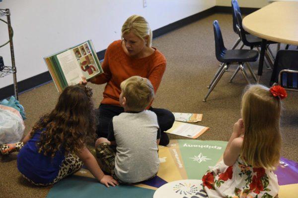 Faith mentor reading a story